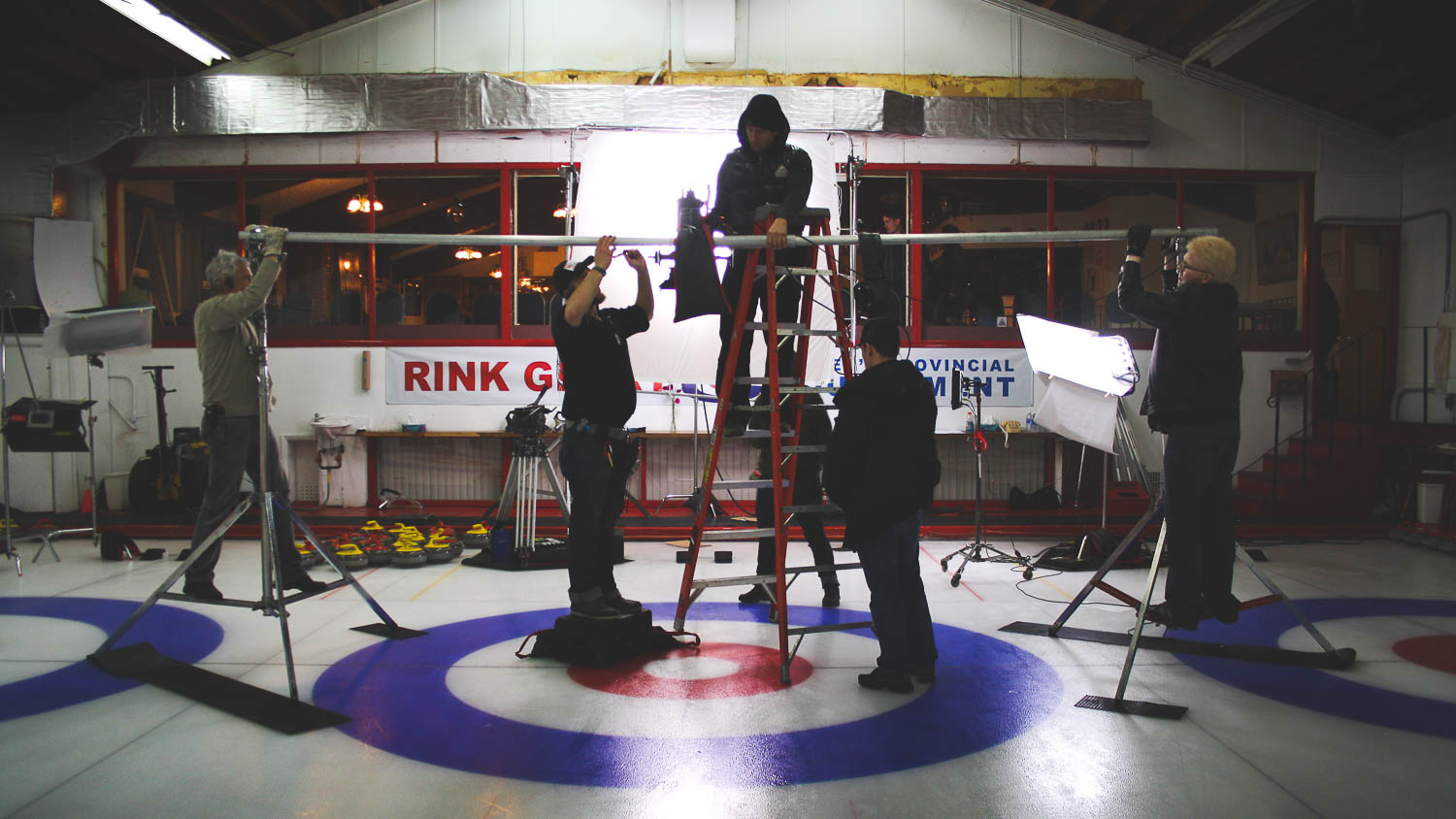 During the reshoot of a scene from the film Sweeping Forward of the Director Patricia McDowell, preparation for an interior scene of the ice ring in a curling tournament.
