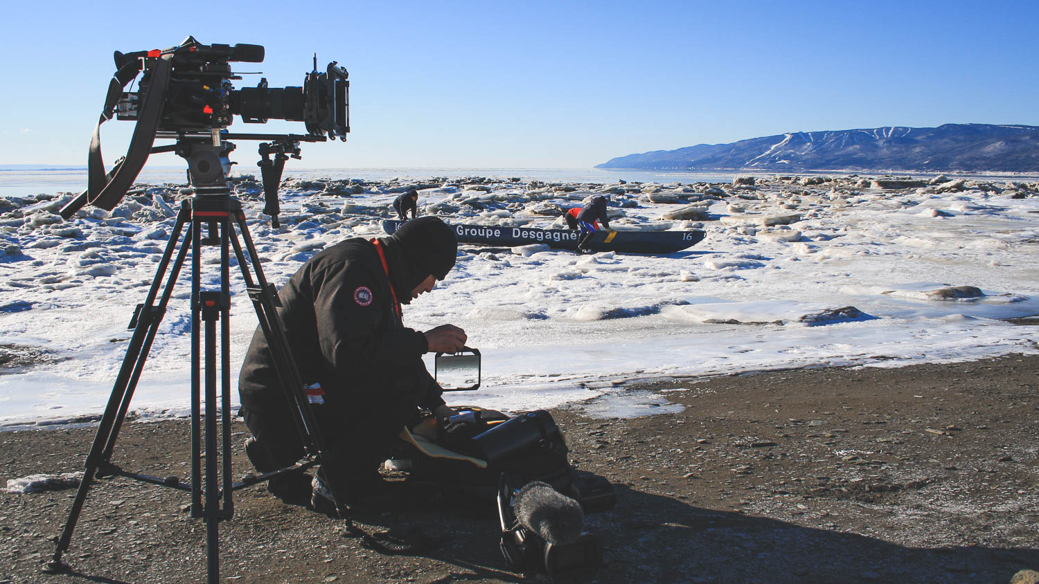 Filming of the TV Show Les Grands Sentiers living winter. The team was at l'Isle-aux-Coudres, in the middle of the Saint-Laurent river during winter to film an ice canoe competition. Director photo Richard Duquette changing a filter glass on the shore of the island